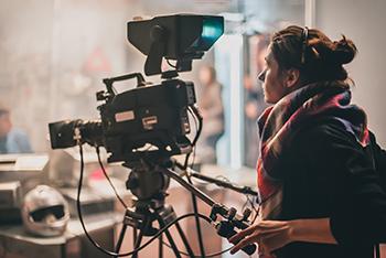 Woman behind a studio film camera